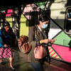 Two women walk in a Mexico City subway station during the coronavirus crisis.