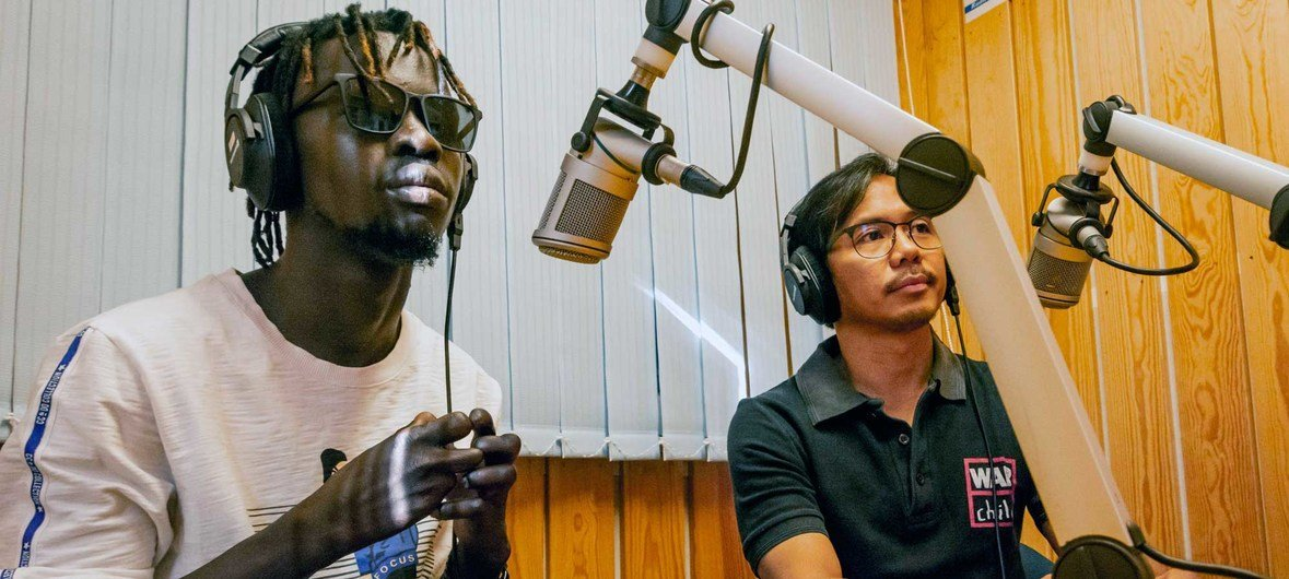 On Radio Miraya's early morning show in South Sudan, Afro-Beat artist Check-B Magic (left) and a representative of the civil society organization War Child Holland discuss his song 'COVID/Corona, which raises awareness about Coronavirus.