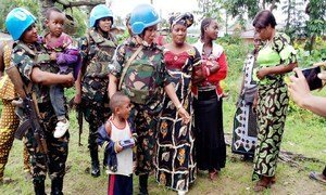 Female peacekeepers from Tanzania interact with women and children in Beni,  DRC