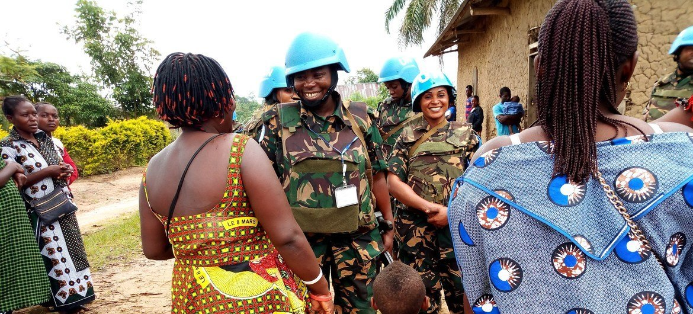 Tanzanian female peacekeepers interact with women in Beni, DRC.