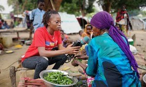 Central African reporter Merveille Noella Mada-Yayoro reporting on conditions at Birao IDP camp. for Guira FM, the UN peace mission's radio in CAR.
