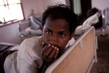Man with AIDS being cared for in a hospital in India.