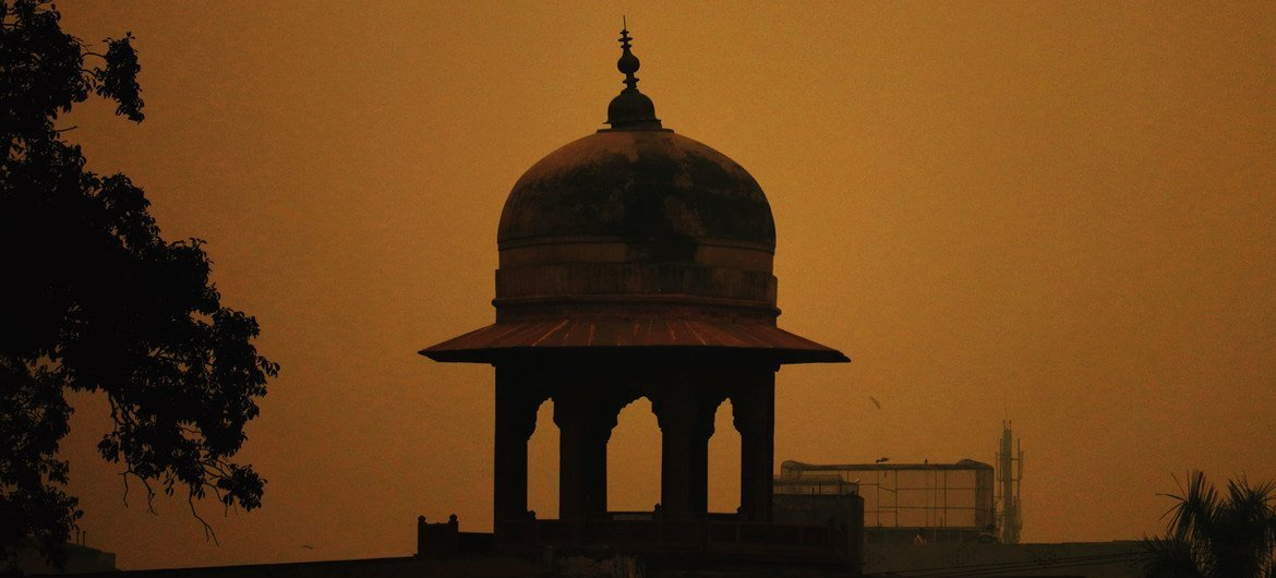 The dome of a Mosque in Pakistan as the sun rises.