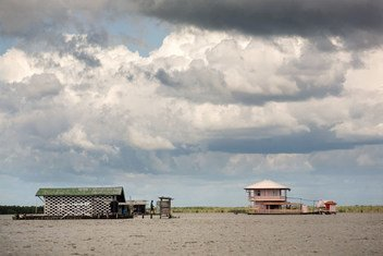 Much of Suriname's coastal area is low-lying and susceptible to natural disasters.