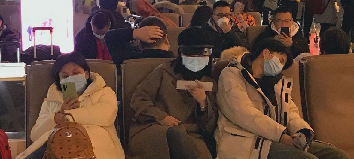 People wear face masks in the waiting area at China's Shenzhen Bao'an International Airport.