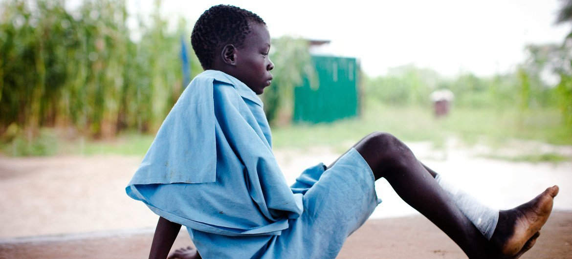 A young boy who has just received treatment for Guinea worm disease in South Sudan.