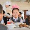 A 9-year-old girl eats lunch at a primary school in Turkestan city, Kazakhstan.