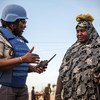 A female UN peacekeeper interacts with a local woman in the Ménaka region of Mali.