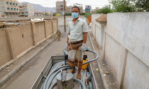 A man works on a water truck delivering water to communities in Sana'a, Yemen, where UNICEF is providing families with access to clean water during the COVID-19 pandemic.