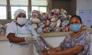 Take-home rations are given to parents of children in Colombia who are missing out on school meals due to COVID-19 school closures.