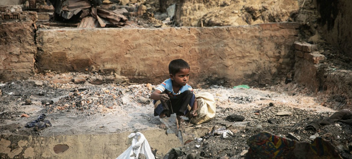 A kid  rummages done  debris aft  a monolithic  occurrence  devastated the Balukhali country  of the Rohingya exile  camps successful  Cox's Bazar.