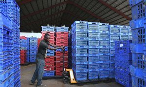 A worker moves stock in a factory producing fruit drinks in Accra, Ghana. (file)