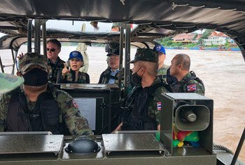 The UN Resident Coordinator in Thailand, Gita Sabharwal (centre background) joins a patrol on the  Mekong River.