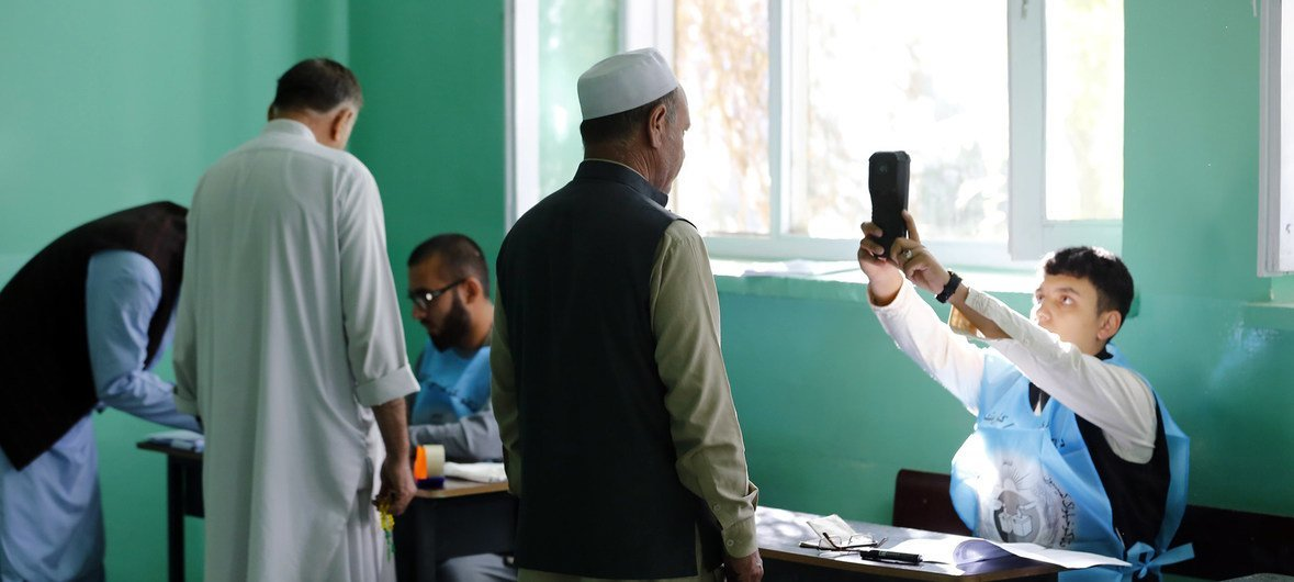 Men vote in the presidential election at a polling station at Zarghoona Girls High School  in  Kabul.