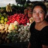A woman attends her produce post in a market in zone 3, Guatemala City, Guatemala. (August 2009)