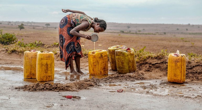 A woman collects rain water on a road in drought-stricken southern Madagascar.