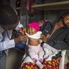 A health worker examines one-year-old Beatrice in a health clinic in Yola, Adamawa state, northeastern Nigeria.