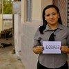 Une femme au Brésil signale son désir d'un monde plus égalitaire.