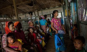 Women and children from a local community at a health centre in Sittwe, in Myanmar's northern Rakhine state. (file photo)