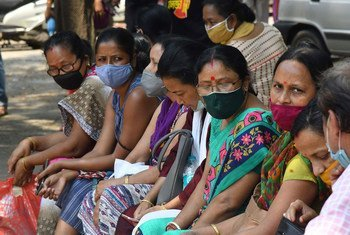 People wait for a COVID-19 vaccination at a state dispensary in Guwahati, India, on April 29, 2021.