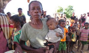 A mother waits to receive food for her child in drought-affected southern Madagascar.