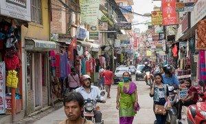 People walk down a street of shops in Kathmandu, Nepal. (file)