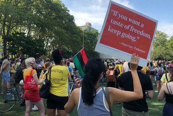 Protesters gather at a park in Brooklyn, New York City to demonstrate against racism and police violence.