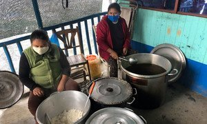 Community kitchen serves hot lunches for Peruvians.