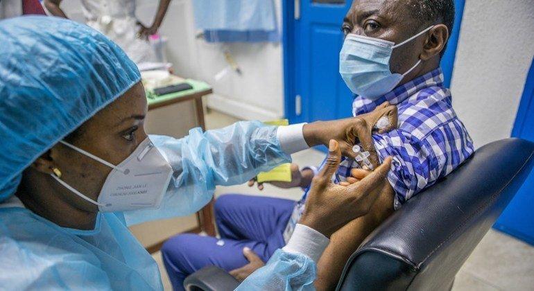 A UN staff member in Benin receives the COVID-19 vaccine in the capital Cotonou.