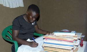 A teenage student studies at home during the COVID-19 lockdown in Uganda.