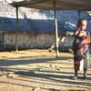 A young boy holds a chicken in Taremb, Malekula Island, Vanuatu.