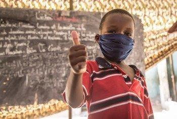An eight-year-old child  in Nouakchott, Mauritania, gives a thumbs-up after an awareness session on preventing COVID-19.