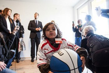 Celebrating the handover of housing units to Roma community members in Serbia (file)