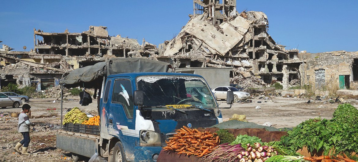 Vegetables are sold amidst the rubble of the old town of Benghazi in Libya.