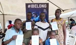 Children at a camp for displaced people in Nigeria receive birth certificates, an important document to proved their nationality.
