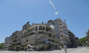 A child flies a kite on a street in the Gaza Strip where an Israeli airstrike took place.