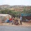 A family fleeing hostilities in Idlib set up a makeshift camp in Aqrabat village, near the Turkish border. (3 June 2019)