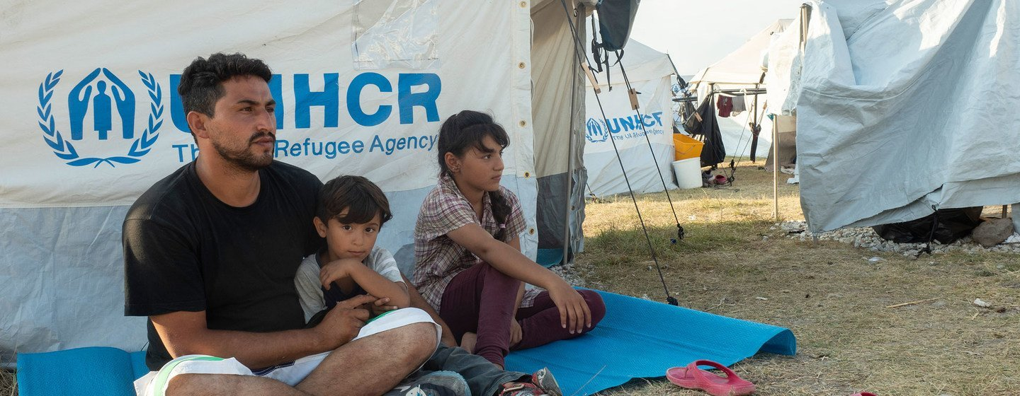 A 33-year-old man from Afghanistan, pictured with his family on the Greek island of Lesvos, is hoping to be relocated to Germany.