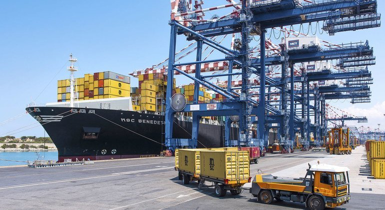 A container ship unloads at the port of Gioia Tauro in Italy.