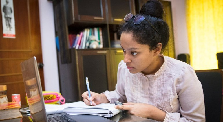 17-year-old Agnidrohee Spondon, a grade 10 student, is studying at home during Bangladesh's indefinite national lockdown to suppress the COVID-19 pandemic.