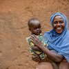 A HIV-positive woman and her baby take their medication on a daily basis at their home in Mbarara, western Uganda.