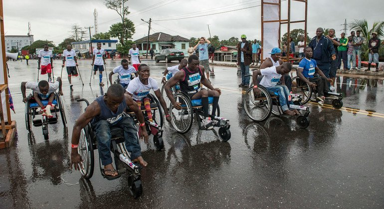 Disabled Liberian atheletes push their wheelchairs forward at the start of a 10k mini marathon for disabled persons in downtown Monrovia, Liberia (file photo).