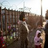 A teenage activist speaks with a young girl in an informal settlement on the outskirts of Johannesburg, South Africa (file photo).