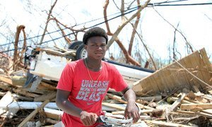 Fifteen-year-old Benson Etienne and his family escaped before their house collapsed in hurricane-hit Marsh Harbour, Abaco Island, Bahamas. (September 2019)