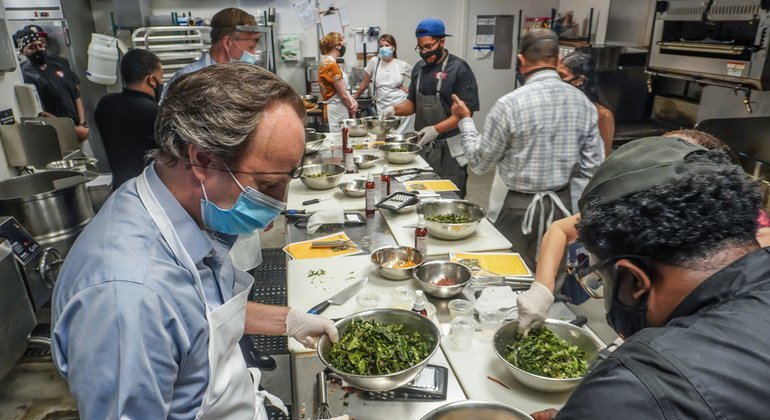 UN officials and ambassadors cook a sustainable meal, at the Brownsville Community Culinary Centre, at an event to raise awareness of food waste