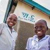 Des élèves, membres de la brigade de santé devant les latrines de l'école primaire Dikolelayi à Kananga,dans la province du Kasaï-Occidental, en République démocratique du Congo (RDC)