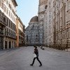 A lone pedestrian in Piazza Del Duomo, a space normally crowded with thousands of visitors..