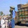 Refugees returning from Pakistan's Katcha Garhi camp