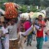 Libériens fuyant les combats