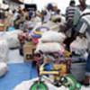 Sierra Leonean returnees unload luggage in Freetown